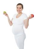 Coma sano. Permanezca seguro durante embarazo Imagenes de archivo