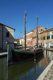Comacchio. (Fe),an old typical fishing boat of the Adriatic Sea in a canal of the city Royalty Free Stock Images