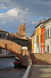 Comacchio, canal bridge. Ferrara, Emiglia Romagna, Italy. A bridge over a canal in the colorful Italian village of Comacchio. Brick stairs leading to the old Royalty Free Stock Images