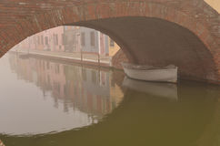 Comacchio, canal bridge in winter. Ferrara, Emilia Romagna, Italy. A bridge over a canal in the colorful Italian village of Comacchio. Old brick bridge across Stock Photography