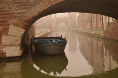 Comacchio, canal bridge in winter. Ferrara, Emilia Romagna, Italy. A bridge over a canal in the colorful Italian village of Comacchio. Old brick bridge across Royalty Free Stock Photos
