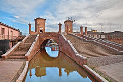 Comacchio, Emilia Romagna, Italy: the ancent bridge Trepponti. Comacchio, Ferrara, Emilia Romagna, Italy: the ancient bridge Trepponti, a famous five-way bridge Stock Photos