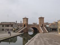 Comacchio, FE, Italy - November 4, 2017: Bridge of Trepponti or. Ponte Pallotta, prospective view of the famous bridge over the canal that crosses the city Royalty Free Stock Photography
