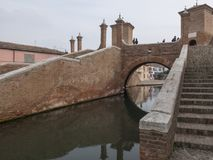 Comacchio, FE, Italy - November 4, 2017: Bridge of Trepponti or. Ponte Pallotta, prospective view of the famous bridge over the canal that crosses the city Stock Photos