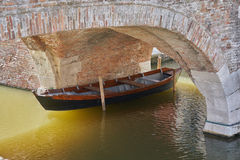 Comacchio Italy March 2017 old boat under the bridge. On canal Stock Photography