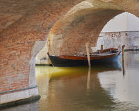 Comacchio Italy March 2017 old boat under the bridge. On canal Stock Photos
