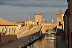 Comacchio, trepponti historic bridge. Ferrara, Italy. Trepponti bridge in Comacchio. Brick stairs leading to the old bridge across the village canals. Province Royalty Free Stock Photos