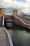 Comacchio, trepponti bridge. Ferrara, Italy. Trepponti bridge in Comacchio. Brick stairs leading to the old bridge across the village canals Stock Photography