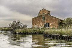 Comacchio valley lagoon. Old red stone fisherman house stock photography