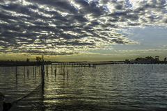Comacchio valley lagoon. Sunrise in the lagoon with a cloudy sky royalty free stock images