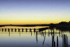 Comacchio valley lagoon. Sunrise in the lagoon with a silhouette in the backgroundn stock photography