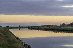 Comacchio valley lagoon. Sunset in a channel in the Po river lagoon stock photography