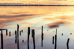 Comacchio valley lagoon. Sunsetl in the Po river lagoon with Comacchio village in the backgroundn stock photo