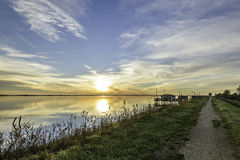 Comacchio valley lagoon. Wood fisherman houses in the lagoon royalty free stock image