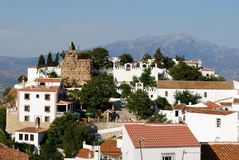 Comares, Andalusia, Spain. View of the town and castle with mountains to the rear, Comares, Axarquia region, Malaga Province, Andalusia, Spain, Western Europe Royalty Free Stock Image