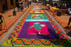Traditional Sawdust carpet religous festival Honduras 2018. In Comayagua Honduras a Sawdust colored carpet on a traditional festival with religous images stock photography