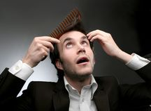 Comb 18. A man combing his hair Royalty Free Stock Photography