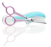 Comb abd scissor Royalty Free Stock Photos