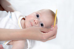 Comb and baby care Royalty Free Stock Photos