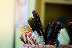 Comb in barber shop for hairdresser makes hairstyle with hair cl stock image