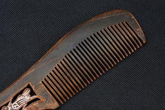 Comb. On a black background Royalty Free Stock Photos