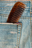 Comb in blue jean. Royalty Free Stock Image