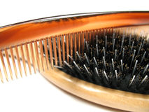 Comb and brush close-up. A close-up picture of a hairbrush and a comb Stock Photos
