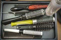 Comb brushes with hair Stock Photo