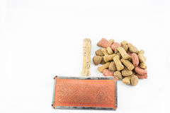 Comb and dog food. Royalty Free Stock Photo