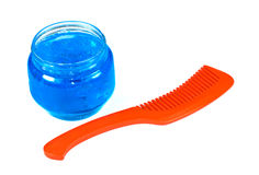 Comb and gel on hair. Red comb and blue gel on hair Stock Photography