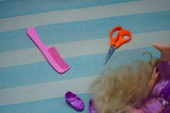 Comb,hair,doll and scissors stock photography