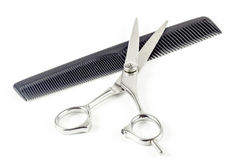 Comb and hair scissors Royalty Free Stock Photos