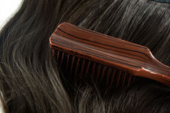 Comb, hairbrush and hair Royalty Free Stock Images