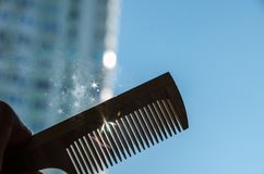 Comb in the hand against the sky royalty free stock photography