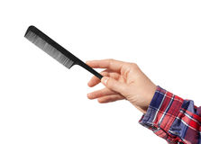Comb in the hand isolated on a white background. Comb in the hand isolated on white background Royalty Free Stock Image