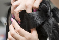 Comb one's black hair Royalty Free Stock Image
