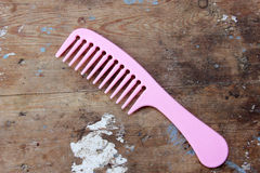 Comb. Plastic comb on rustic wooden background royalty free stock photos
