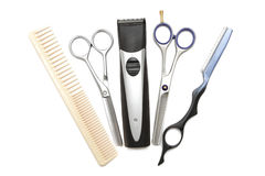 Comb, scissor, clippers and hair trimmer. Hairdressing industry. Professional hairdressing tools. Comb, scissor, clippers and hair trimmer isolated on white stock photography