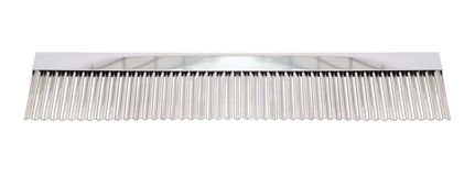 Comb stainless ridged cutter for bakery. On white background Stock Photography
