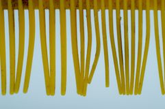 Broken hair comb on white blackgroud stock photography