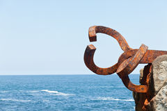Comb of the Winds. San Sebastián, Spain, June 17, 2012. Comb of the Winds, by Eduardo Chillida, in the Bay of San Sebastian, Spain Royalty Free Stock Photo