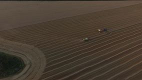 Combaines harvesters and truck on wheat field aerial view.  stock video footage