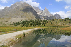 Combal lake and aiguille noire Royalty Free Stock Image