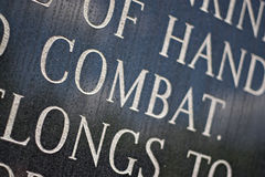 Combat. A closeup of the word COMBAT engraved on a war memorial plaque. Shallow depth of field royalty free stock images