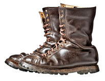 Combat boots. Isolated used combat leather boots Royalty Free Stock Images