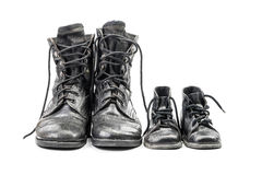 Combat boots for adult and kid. Dirty combat boots for adult and kid isolated on white background with clipping path Stock Photography
