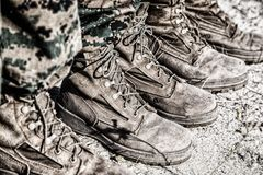 Combat boots in the desert Stock Photo
