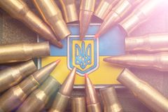 Combat bullets on the background of the Ukrainian flag. Camouflage symbol of the Ukrainian army stock photos