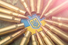 Combat bullets on the background of the Ukrainian flag. Camouflage symbol of the Ukrainian army royalty free stock photo