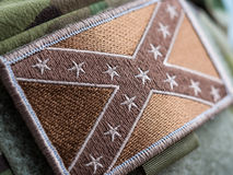 Combat Confederate Flag patch. Green toned Combat Confederate Flag patch close-up, shallow depth of field Royalty Free Stock Images